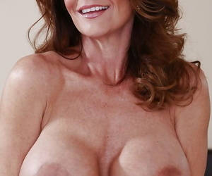 Mature babe with huge boobs teases her nipples and spreads her pussy
