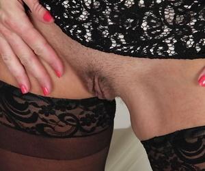 Big titted mature Karen Jones looks hot in the black stockings