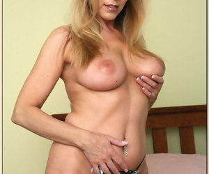 Busty mature Nicole Moore flashing ass upskirt and stripping nude