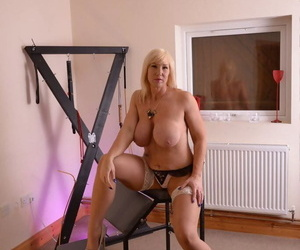 Thundering MILF Atmosphere gets topless and reveals say no to wold salmagundi breasts
