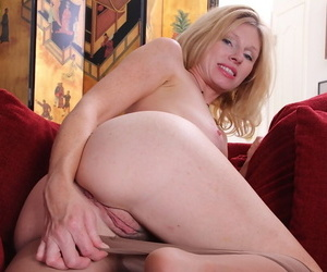 Mature blonde Holly Jones spreads her legs in tight pantyhose