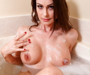 Amazingly sexy mature brunette taking bath and fingering her slit