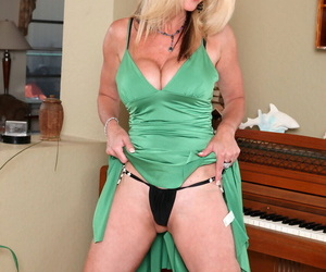 Blonde piano player Cassy Torri with natural tits tickles pussy with vibrator