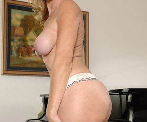 Mature blonde with big tits and nipples Jenna spreading that ass