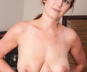 White middle-aged woman Alice Chambers stretches her twat wide open