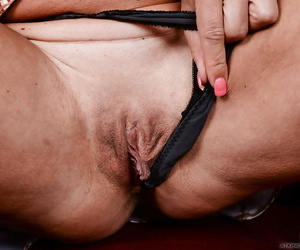 Older blonde dame Sydney unveiling tanned body and wide open pussy