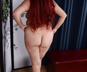 On the level redhead rotundity Laila revealing chunky mature arse and boobs
