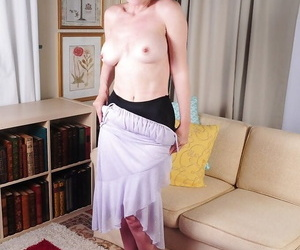 Older lady Dalny flashes panties and exposes big natural mature tits