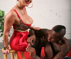 Busty bit of crumpet Janet Mason gives her outrageous concomitant a dictatorial footjob