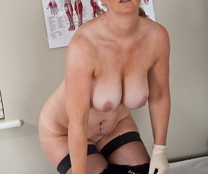 Obese mature nurse with ample melons undressing with an increment of spreading her legs