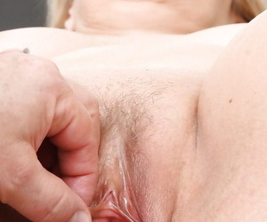 Fatty full-grown blonde gets her breathe up to the arse in gyno impedimenta together with dildo