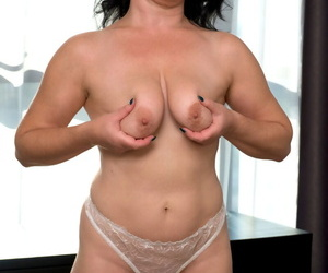 Mature lady Helen He showcases her shaved vagina in white stockings