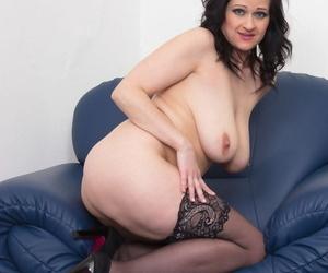 Big boobed MILF Dominika S toys her mature vagina in black stockings