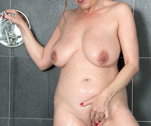 Fat number aged lady gets dressed charges taking a tonic shower