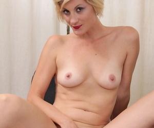 Serious mature Jayden Monroe adores masturbating and reaching climax