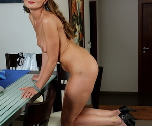 Older babe Michelle Gaia strips and teases her shaved mature crotch