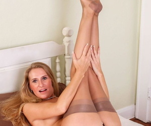 Middle-aged American lady Sara James removes her lingerie before masturbating