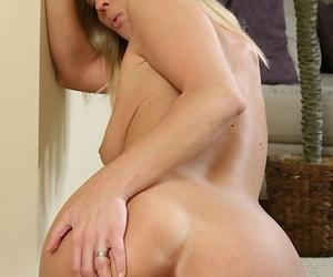 Bosomy blonde MILF with ample fanny toying her shaggy twat