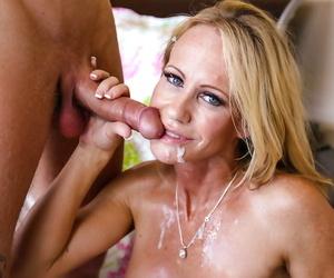 Cumshot scene features mature mom Simone Sonay doing handjob