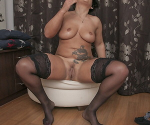 Mature fit together Aisha Bahadur services her horny pussy relating to a distress cock