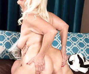 Full-grown blonde little one Vikki Vaughn exposing saggy chest before hulking blowjob