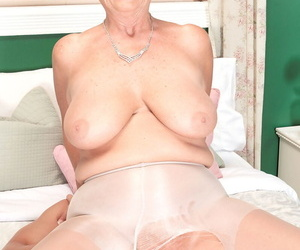 Brusque haired nan Joanne Entrust performs hardcore intercourse acts relating to her kickshaw boy