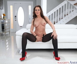 Hot mom Gia Giacomo doffs lingerie to show off her goods in black stockings