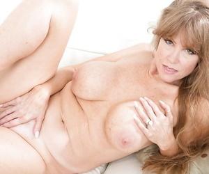 Busty older mom Darla Crane maintaining her pornstar looks and great legs