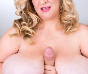 Blonde BBW Cami Cooper applies whip cream to a cock while giving a blowjob