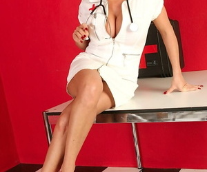 Mature nurse Alicia DiMarc flashes her burly gut together with shaved pussy