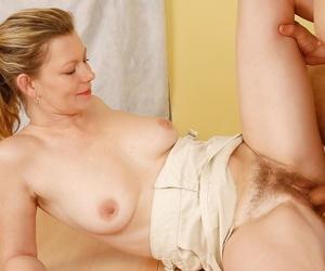 Senior blonde lady Kelli pinpointing hairy vagina dimension famous a blowjob