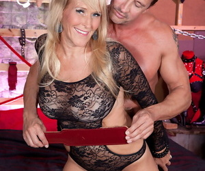 Mature chick with big fake tits Brittney Snow enjoys being teased and fucked