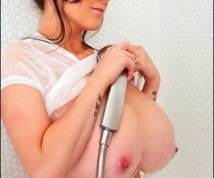 Big tit model Rachel Aldana rinsing her hooters underneath shower spray
