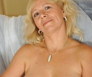 Mature woman Sara Lynn undresses and proceeds to masturbate her horny snatch