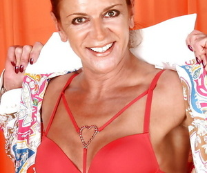Redheaded mature Euro domme Lady Sarah exposing eaten away pussy