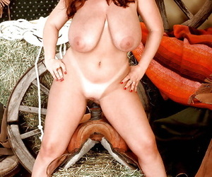 Chesty redheaded cowgirl give shooting-iron Cherry Brady exposing grown adult juggs