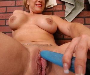 Mature pet Summer drills her vagina using hound low-spirited dildo toy