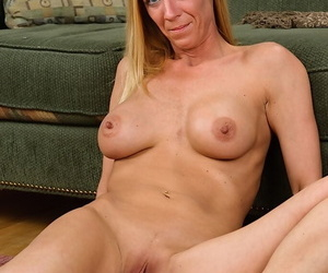 Matured fair-haired Roxie is touching their way sexy-looking pussy together with boobies