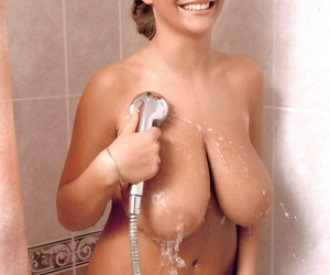 Solo model Ines Cudna proudly displays her all natural knockers in the bathtub