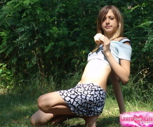 Skinny flat chested young girl teases with abs bare in short skirt outdoors
