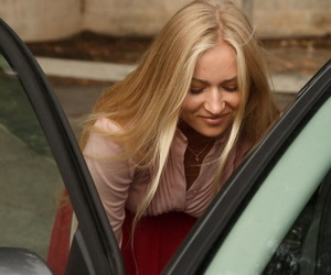 Blonde woman Ira Greene lifts up her skirt in parking number increased by inner the hoard