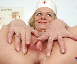 Lascivious mature nurse taking off her panties and exposing her twat