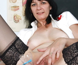 Lusty mature nurse in stockings masturbating her vag by different toys