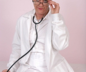 Lusty mature doctor in glasses and stockings undressing and teasing herself