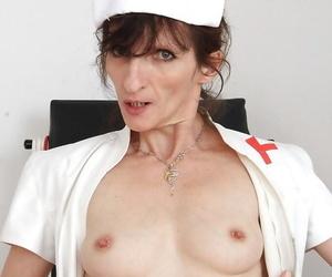 Naughty bug nurse Andula trade mark Day-Glo granny tits and pussy far hospital enclosure