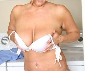 Chubby mature sorrow with big saggy special undressing coupled with spreading her cunt