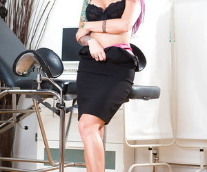 Hot female doctor Monique Alexander doffing lab coat and clothes to pose naked