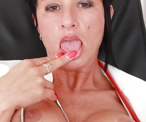 Juggy mature nurse taking off her panties and teasing her gash in close up