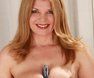 Thick grown up lady Susi doffs her leather nurse outfit to gewgaw her hairy bush
