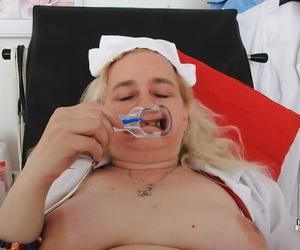 Mature nurse Elena using speculum to stretch hairy mature pussy